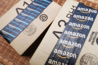 Former Amazon Manager Sues For Overtime Wages