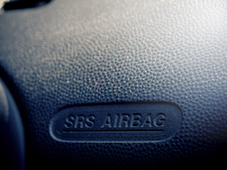 Victim with Broken Wrist Blames Airbag and Hand Grip